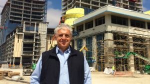 Legacy West developer Fehmi Karahan in front of his nearly completed development in Plano